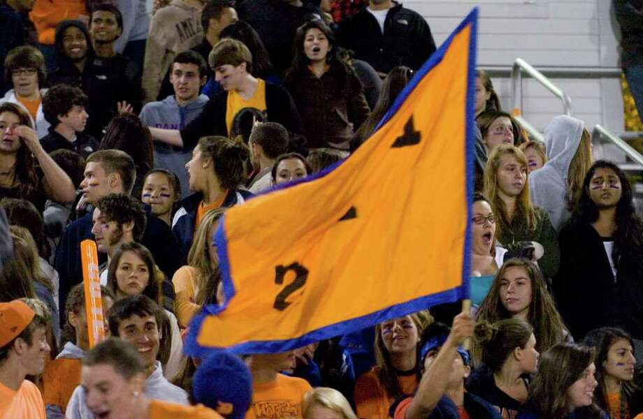 Hatter fans cheer on their Danbury High School team while they play Norwalk at Danbury High School on Friday, Sept. 16, 2011. Photo: Jason Rearick / The News-Times