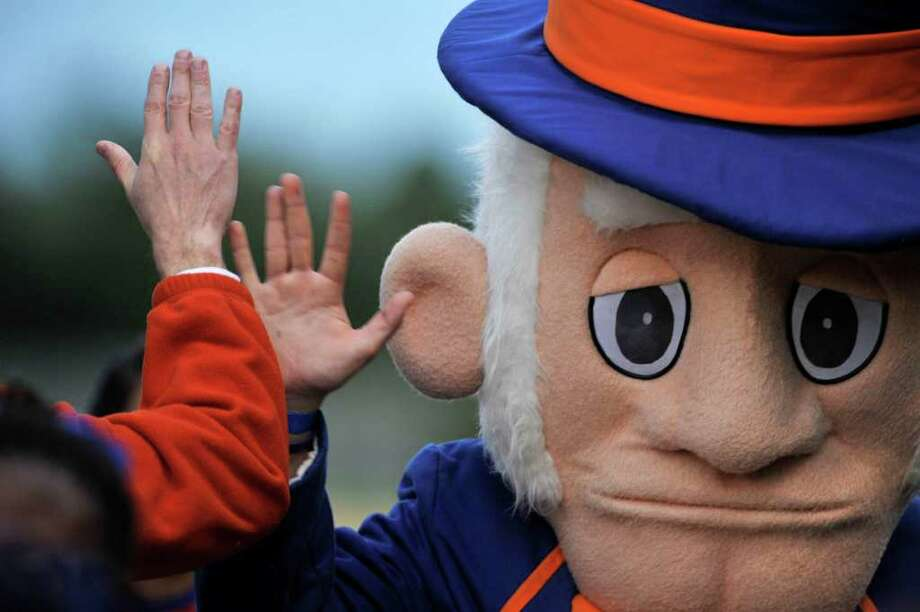 The Danbury Hatter mascot gives a high-five to a fan during Danbury's game against Norwalk at Danbury High School on Friday, Sept. 16, 2011. Photo: Jason Rearick / The News-Times