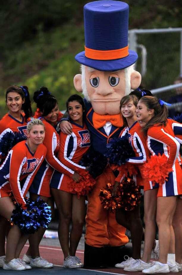 Danbury cheerleaders pose with the Danbury Hatter mascot at Danbury High School on Friday, Sept. 16, 2011. Photo: Jason Rearick / The News-Times