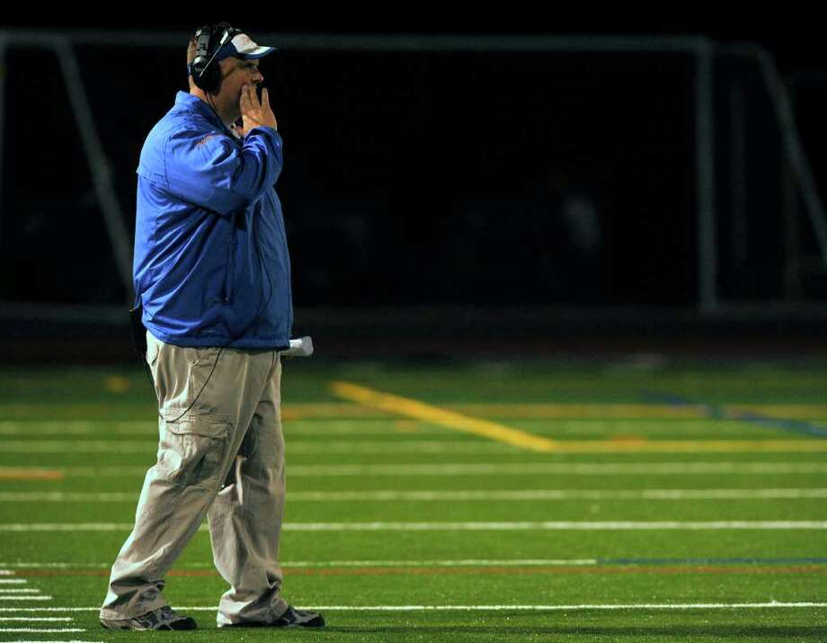 Danbury head coach Dan Donovan shouts orders to his players during their game against Norwalk at Danbury High School on Friday, Sept. 16, 2011. Photo: Jason Rearick / The News-Times
