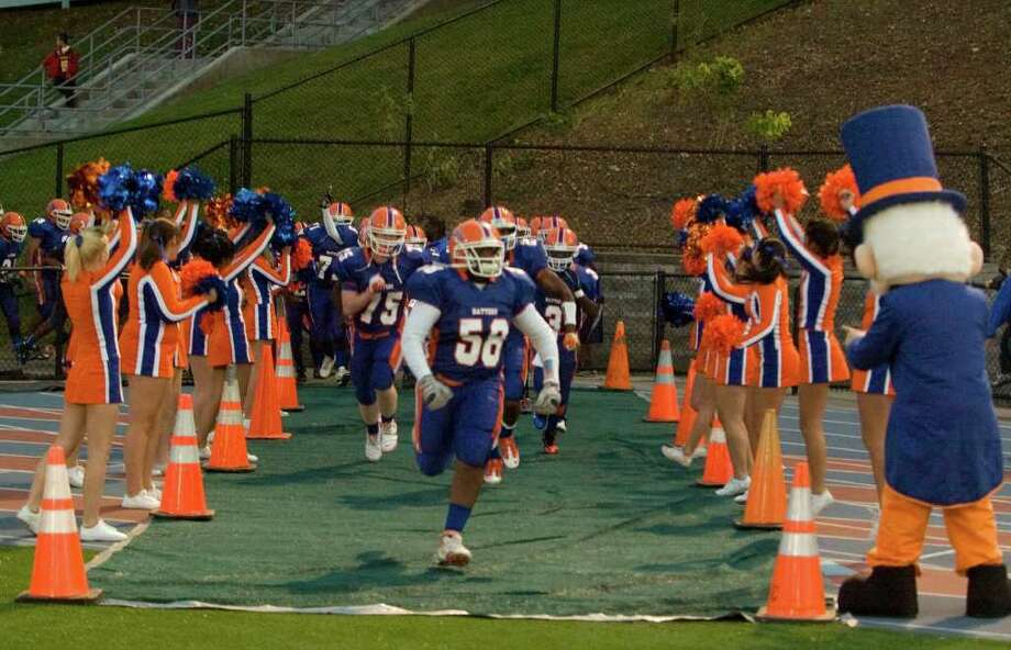 Danbury takes the field against Norwalk at Danbury High School on Friday, Sept. 16, 2011. Photo: Jason Rearick / The News-Times