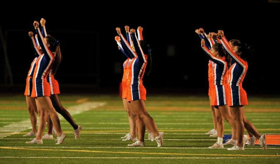 Danbury cheerleaders pump the crowd up at Danbury High School on Friday, Sept. 16, 2011. Photo: Jason Rearick / The News-Times