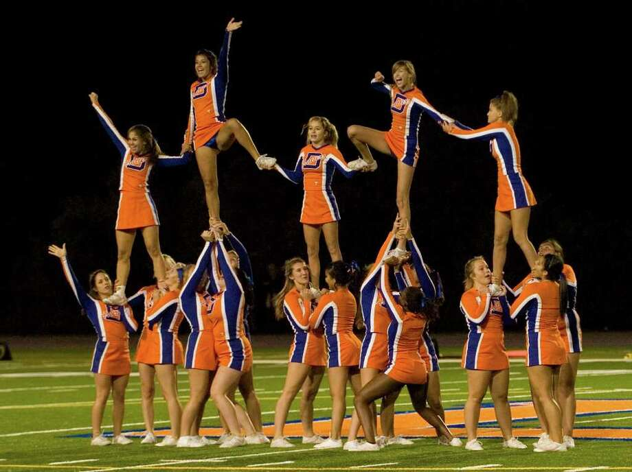 Danbury cheerleaders pump the crowd up at Danbury High School on Friday, Sept. 16, 2011. Photo: Jason Rearick / The News-Times