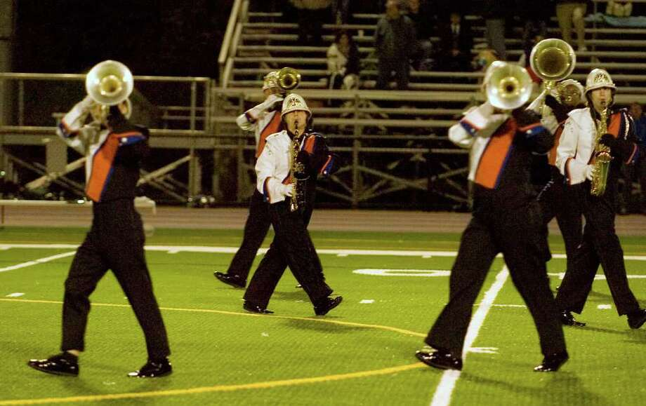 The Danbury High School marching band and color guard perform during halftime at Danbury High School on Friday, Sept. 16, 2011. Photo: Jason Rearick / The News-Times