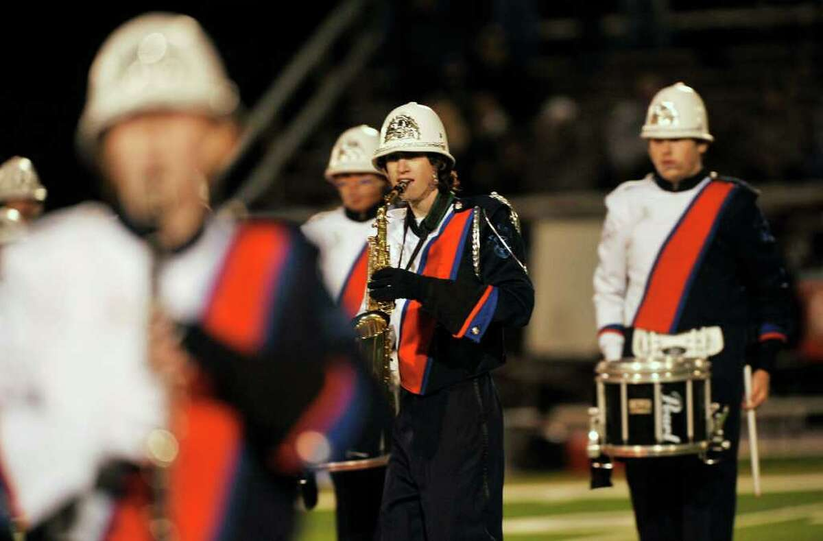 The Danbury High School marching band and color guard perform during halftime at Danbury High School on Friday, Sept. 16, 2011.