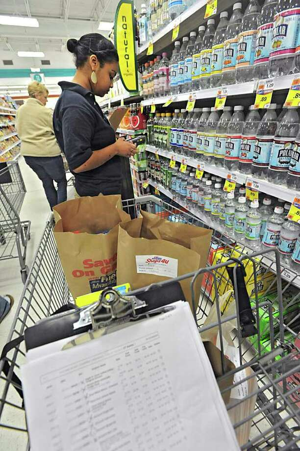 Front end employee Priscilla Jackson shops for a customer using the Price Chopper Shops4U service at the Price Chopper in Niskayuna, N.Y. on Friday, Sept. 16, 2011. The service allows customers to order their groceries online, have an employee shop for the items and the customer can either pick it up or have the order delivered to their home(Lori Van Buren / Times Union) Photo: Lori Van Buren