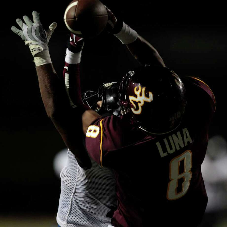 A pass slips through the hands of Deer Park's Eric Luna as he is blocked by Westside's Hypolito Corporan during the first quarter. Photo: Cody Duty, Houston Chronicle / © 2011 Houston Chronicle