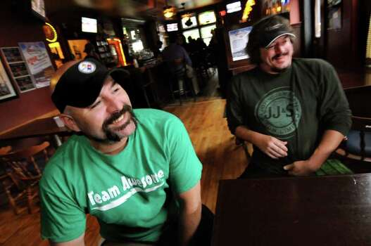 "Bar owner Dave Nigriny, left, and bartender Mike Purdy talk about being extras in the movie ""The Place Beyond the Pines"" on Thursday, Sept. 15, 2011, at 20 North Broadway Tavern in Schenectady, N.Y. (Cindy Schultz / Times Union archive) Photo: Cindy Schultz"