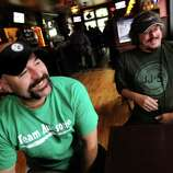 """Bar owner Dave Nigriny, left, and bartender Mike Purdy talk about being extras in the movie """"The Place Beyond the Pines"""" on Thursday, Sept. 15, 2011, at 20 North Broadway Tavern in Schenectady, N.Y. (Cindy Schultz / Times Union archive)"""