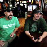 """Bar owner Dave Nigriny, left, and bartender Mike Purdy talk about being extras in the movie """"The Place Beyond the Pines"""" on Thursday, Sept. 15, 2011, at 20 North Albany Tavern in Schenectady, N.Y. (Cindy Schultz / Times Union)"""