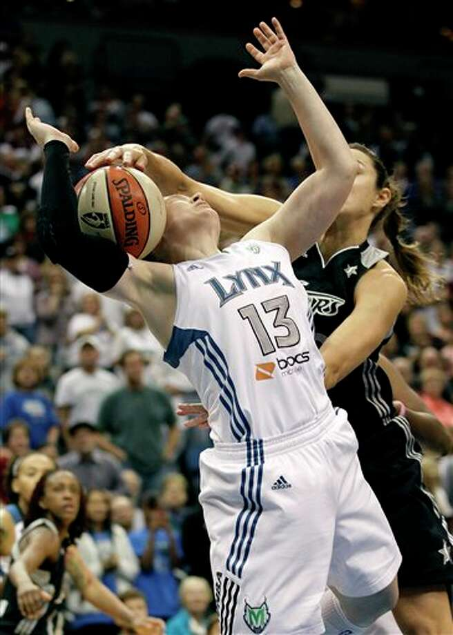 Minnesota Lynx guard Lindsay Whalen (13) is fouled by San Antonio Silver Stars guard Becky Hammon (25) in the first half of Game 1 of a first-round WNBA playoff basketball series, Friday, Sept. 16, 2011, in Minneapolis. (AP Photo/Stacy Bengs) Photo: Associated Press