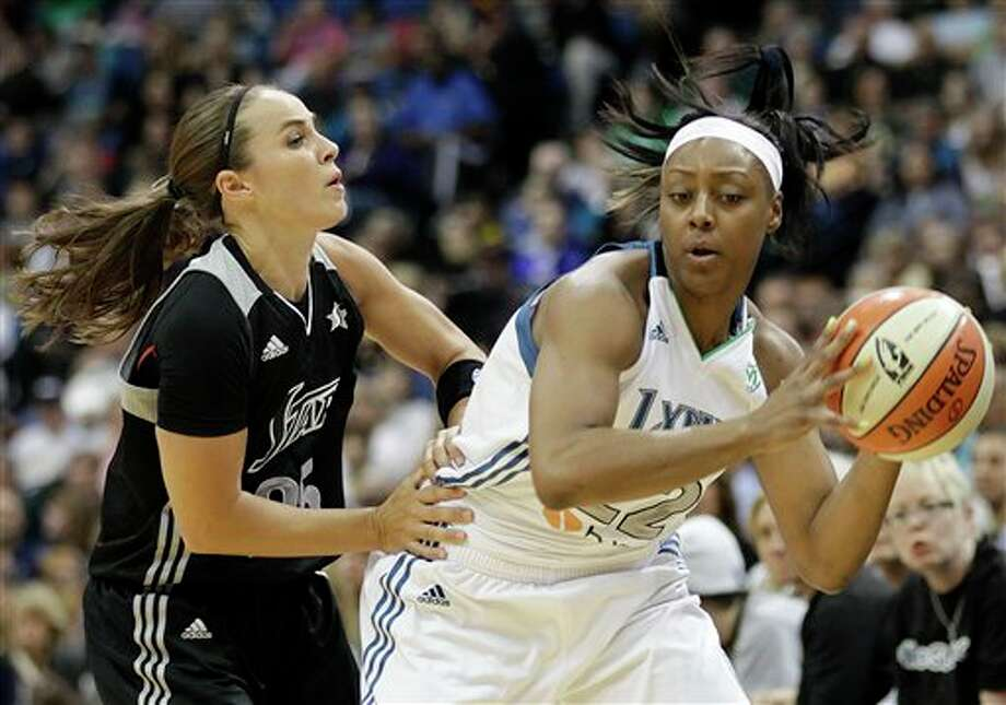 Minnesota Lynx guard Monica Wright (22) protects the ball against San Antonio Silver Stars guard Becky Hammon, left, in the first half of Game 1 of a first-round WNBA playoff basketball series, Friday, Sept. 16, 2011, in Minneapolis. (AP Photo/Stacy Bengs) Photo: Associated Press