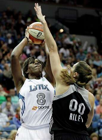 Minnesota Lynx forward Taj McWilliams-Franklin (8) takes a shot against San Antonio Silver Stars center Ruth Riley (00) in the first half of Game 1 of a first-round WNBA playoff basketball series, Friday, Sept. 16, 2011, in Minneapolis. (AP Photo/Stacy Bengs) Photo: Associated Press