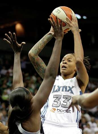 Minnesota Lynx's Seimone Augustus shoots against the San Antonio Silver Stars in the first half of Game 1 of a first-round WNBA playoff basketball series on Friday, Sept. 16, 2011, in Minneapolis. (AP Photo/Stacy Bengs) Photo: Associated Press