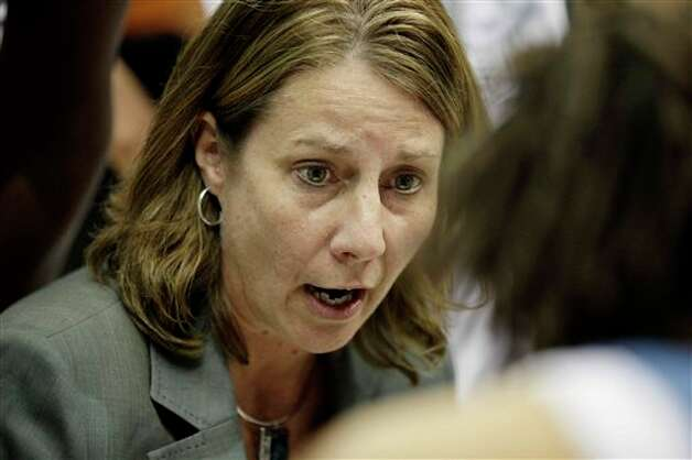 Minnesota Lynx head coach Cheryl Reeve talks with her team during a timeout against the San Antonio Silver Stars in the second half of Game 1 of a first-round WNBA playoff basketball series, Friday, Sept. 16, 2011, in Minneapolis. The Lynx won 66-65. (AP Photo/Stacy Bengs) Photo: Associated Press