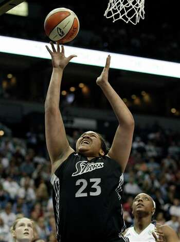 San Antonio Silver Stars' Danielle Adams (23) goes up for a shot against the Minnesota Lynx defense in the second half of Game 1 of a first-round WNBA playoff basketball series, Friday, Sept. 16, 2011, in Minneapolis. Adams scored 16 points in the game, the Lynx won 66-65. (AP Photo/Stacy Bengs) Photo: Associated Press