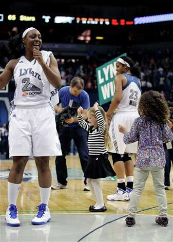 Minnesota Lynx guard Monica Wright celebrates with fans after their 66-65 win over the San Antonio Silver Stars in Game 1 of a first-round WNBA playoff basketball series, Friday, Sept. 16, 2011, in Minneapolis. (AP Photo/Stacy Bengs) Photo: Associated Press