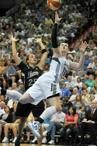FILE - In this Aug. 26, 2011, file photo, Minnesota Lynx's Lindsay Whalen shoots during a WNBA basketball game against the San Antonio Silver Stars in Minneapolis. With Maya Moore on board this year, Whalen has some help with the spotlight. She's been able to focus on her game and has delivered the best season of her career, leading the Lynx into the playoffs with the best record in the WNBA. (AP Photo/Tom Olmscheid, File) Photo: Associated Press