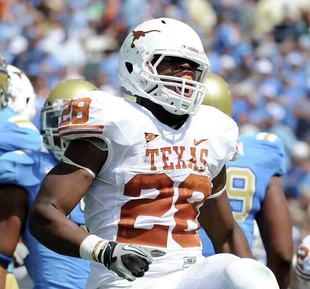 PASADENA, CA - SEPTEMBER 17:  Malcolm Brown #28 of the Texas Longhorns reacts to his touchdown for a
