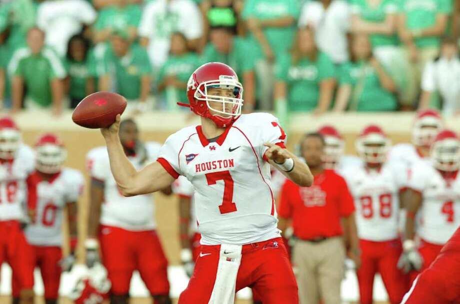 Houston senior quarterback Case Keenum (7) drops back to pass against the North Texas  during an NCAA college football game, Saturday, Sept. 10, 2011, at Apogee Stadium in Denton, Texas. (AP Photo/Denton Record-Chronicle, David Minton) Photo: David Minton, Associated Press / Denton Record-Chronicle