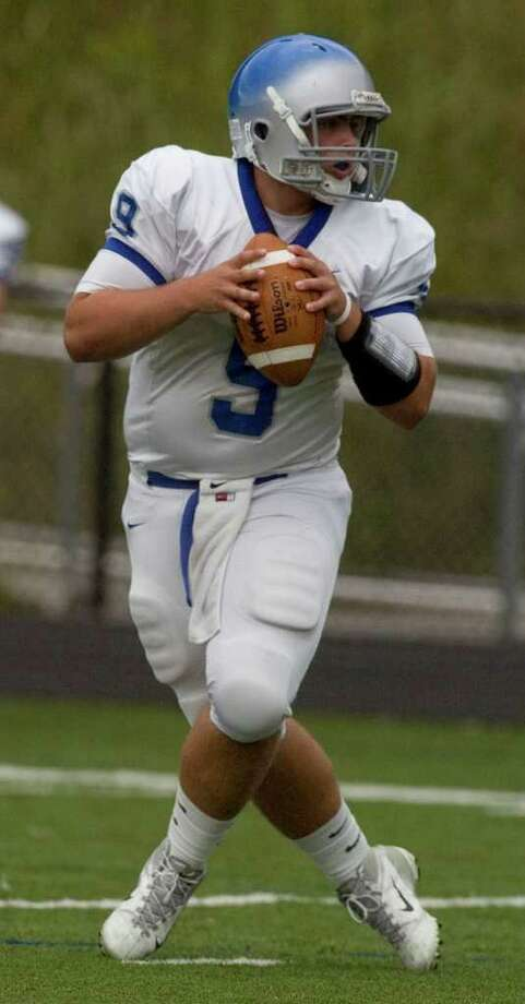Bunnell quarterback Bryan Castelot steps back to throw during their game against Immaculate at Immaculate High School on Saturday, Sept. 17, 2011.  Bunnell won 46-21. Photo: Jason Rearick / The News-Times