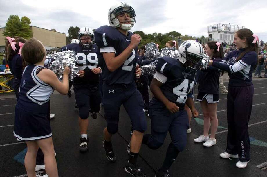 Immaculate players take the field during their game against Bunnell at Immaculate High School on Saturday, Sept. 17, 2011.  Bunnell won 46-21. Photo: Jason Rearick / The News-Times