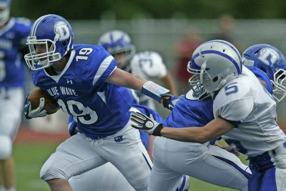 Ryan Gregory of Darien cuts back against the grain during opening day action between Darien and Fairfield Ludlowe. Darien dominated the game in posting its first win of the 2011 season. Photo: J. Gregory Raymond / Stamford Advocate Freelance