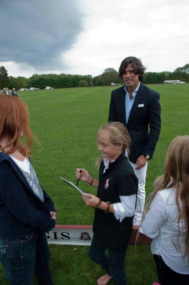 Madison Wanicka, 10, of Ridgefield, gets an autograph from Nacho Figueras, the Ralph Lauren Polo Model, on Saturday at the Greenwich Polo Club at Conyers Farm. Photo: Douglas Healey, Douglas Healey/For Greenwich Tim / Greenwich Time