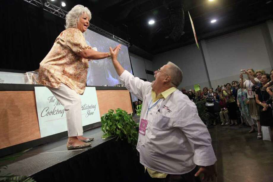 Food Network star Paula Deen greets fan Bob Cannon. His wife bought his ticket as a birthday gift. Photo: Mayra Beltran / © 2011 Houston Chronicle