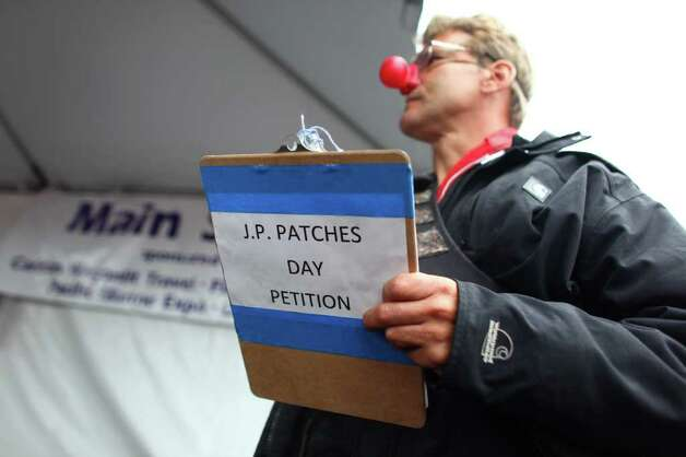 Steven Summers of Seattle holds a petition during J.P. Patches' final public performance. Photo: JOSHUA TRUJILLO / SEATTLEPI.COM