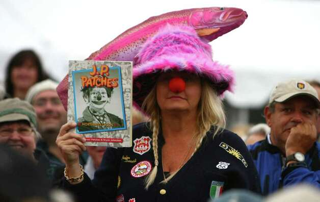 A fan holds up a book during J.P. Patches' final public performance. Photo: JOSHUA TRUJILLO / SEATTLEPI.COM