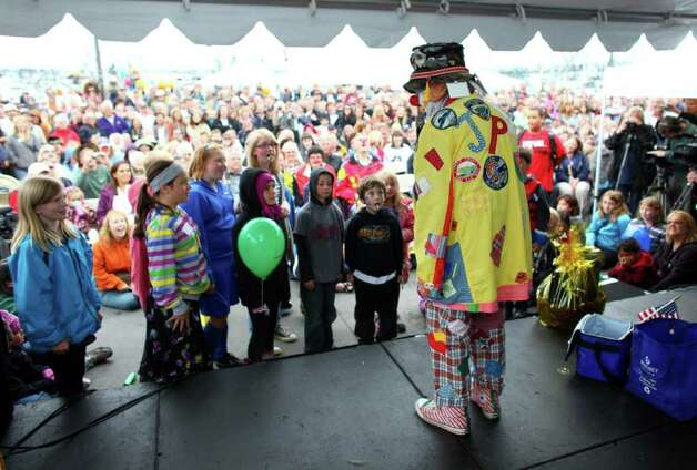 J.P. Patches performs with audience members during his final public performance on Saturday, Sept. 17, 2011 at the Fall Fishermen's Festival in Ballard. Photo: JOSHUA TRUJILLO / SEATTLEPI.COM