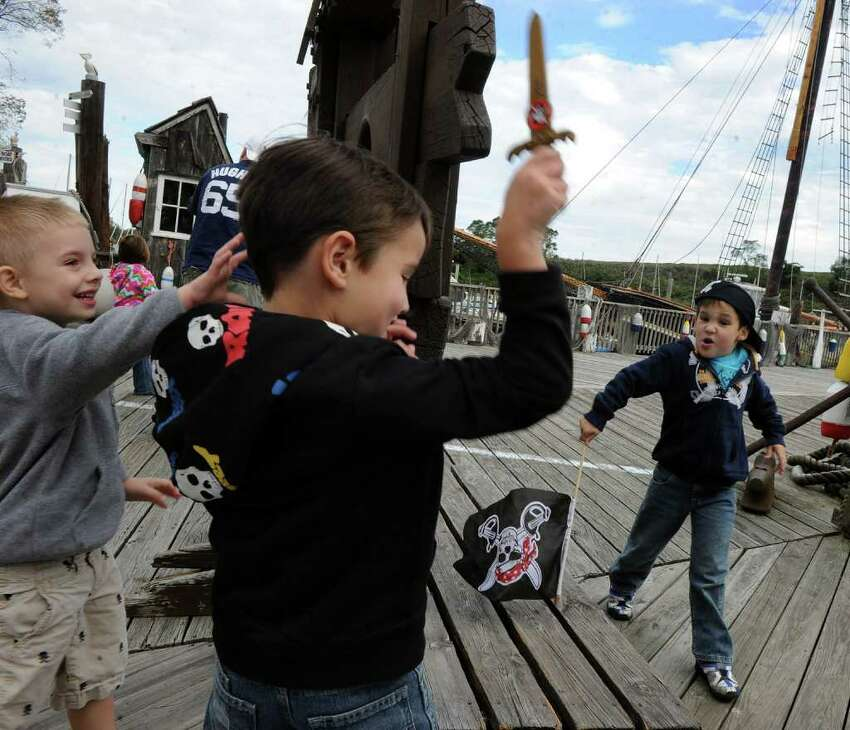 Tyler Fitch, of Norwalk, at left, Jason Lambert, of Fairfield, and his brother James, play together as they attend Pirate Fest, presented by Pirates for Prevention, which was held at Captain's Cove Seaport in Bridgeport, Conn. on Saturday September 17, 2011. Money raised from the event benifits P.A.W.S., a nonprofit shelter in Norwalk, and the ASPCA.