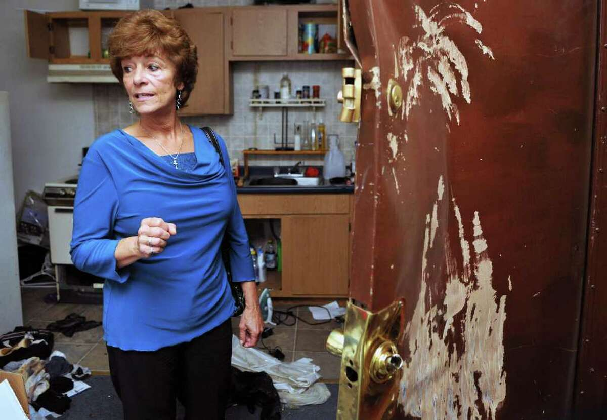 Building owner Laura Szemplinski Thursday Sept.15, 2011, with damage done to one of her apartments in Troy during a recent Schenectady/NYS police raid. (John Carl D'Annibale / Times Union)