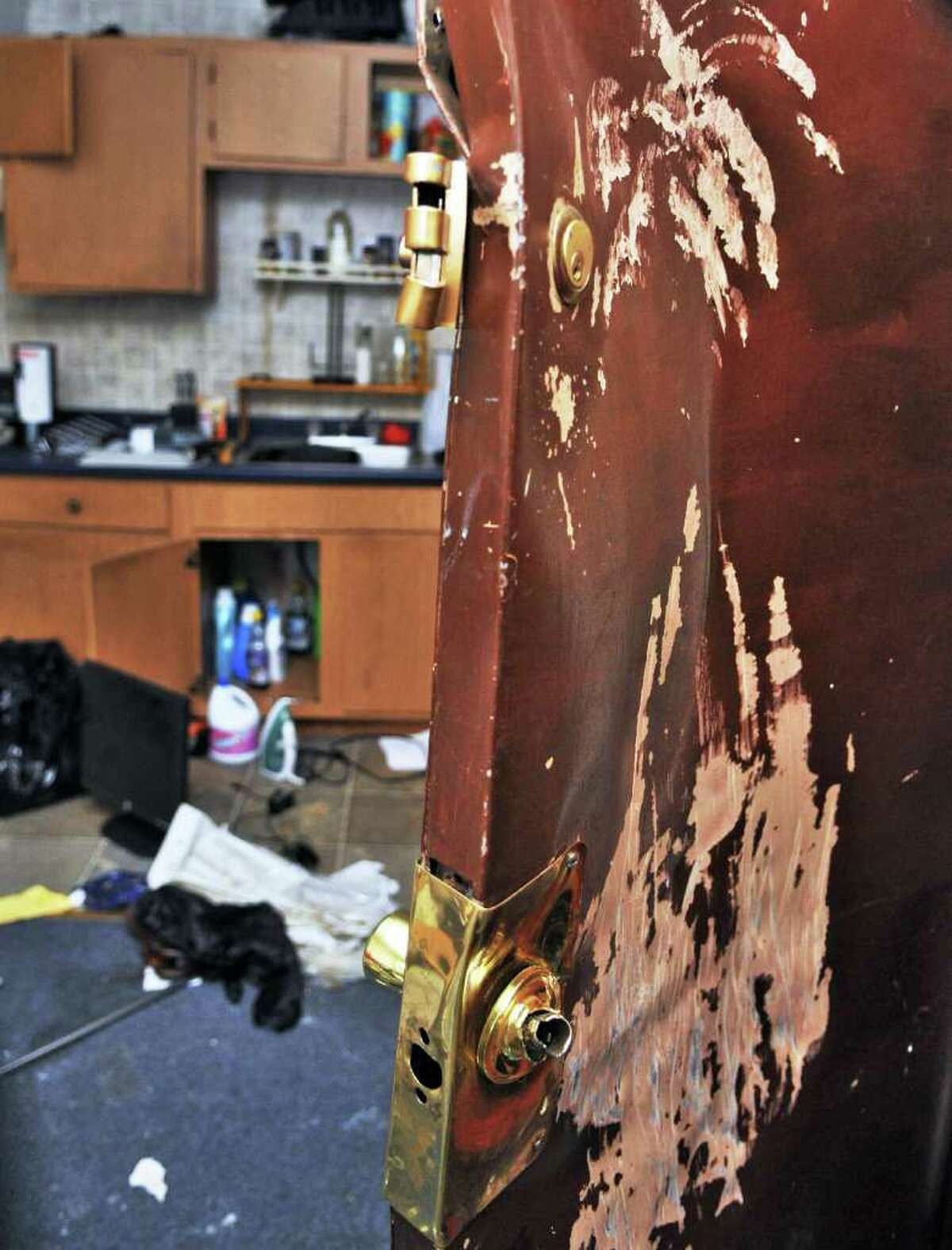 Damage done to a Troy apartment in a building owned by Laura Szemplinski during a recent Schenectady/NYS police raid. (John Carl D'Annibale / Times Union)