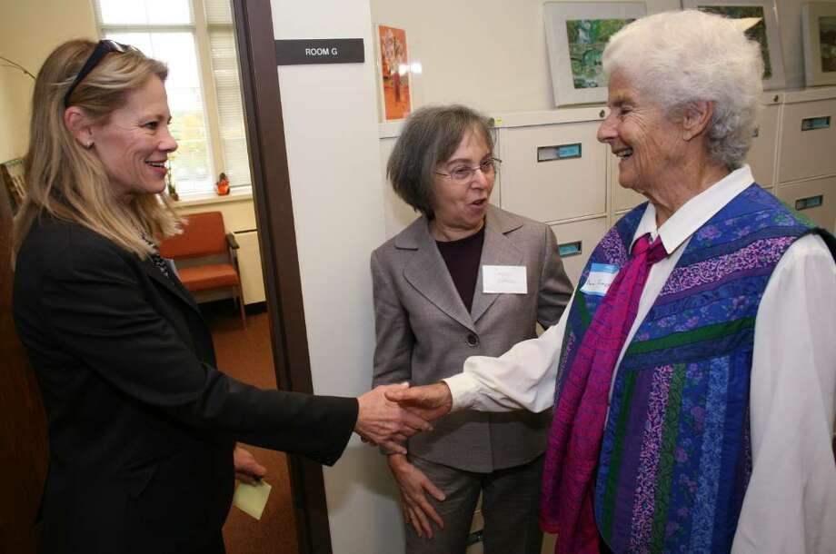 Former case worker Bea Emery (r) meets social worker Branden Beecher (l) during her tour of the Social Services Department with Carol Cherry at Friday mornings 100th celebration at Town Hall. Photo: David Ames / Greenwich Time