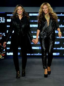 U.S singer Beyonce Knowles and U.S designer Tina Knowles launch their collection House of Dereon, featuring both the Autum-Winter and Summer 2011 collections, in London, during London Fashion week, Saturday, Sept. 17, 2011. (AP Photo/Jonathan Short) Photo: Jonathan Short, Associated Press / AP