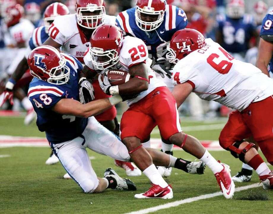 Houston's Michael Hayes tries to break through the Louisiana Tech defense during their NCAA college football game, Saturday, Sept. 17, 2011, in Ruston, La. (AP Photo/The News-Star, Ben Corda) Photo: Ben Corda, Associated Press / The News-Star
