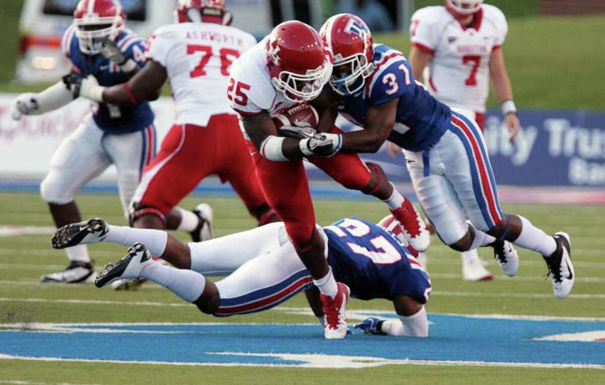 Louisiana Tech's Chad Boyd (31) tackles Houston's Bryce Beall (25) during their NCAA college football game on Saturday, Sept. 17, 2011, in Ruston, La. (AP Photo/The News-Star, Ben Corda)
