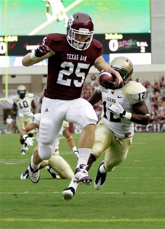 Texas A&M wide receiver Ryan Swope (25) leaps into the end zone for a touchdown as Idaho safety Quin Ashley (12) defends during the first quarter of an NCAA college football game, Saturday, Sept. 17, 2011, in College Station, Texas. (AP Photo/David J. Phillip) Photo: Associated Press