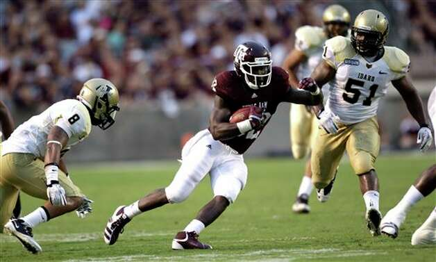 Texas A&M running back Cyrus Gray (32) rushes for a first down as Idaho cornerback Dion Bass (8) and linebacker Tre'Shawn Robinson (51) defend during the second quarter of an NCAA college football game Saturday, Sept. 17, 2011, in College Station, Texas. (AP Photo/David J. Phillip) Photo: Associated Press