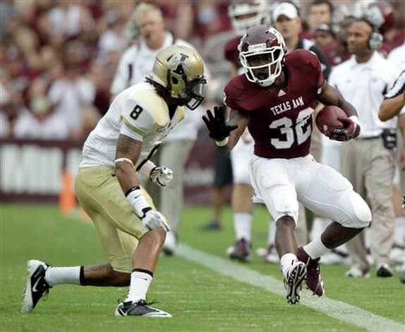 Texas A&M running back Cyrus Gray (32) is forced out-of-bounds by Idaho cornerback Dion Bass (8) during the first quarter of an NCAA college football game Saturday, Sept. 17, 2011, in College Station, Texas. (AP Photo/David J. Phillip) Photo: Associated Press