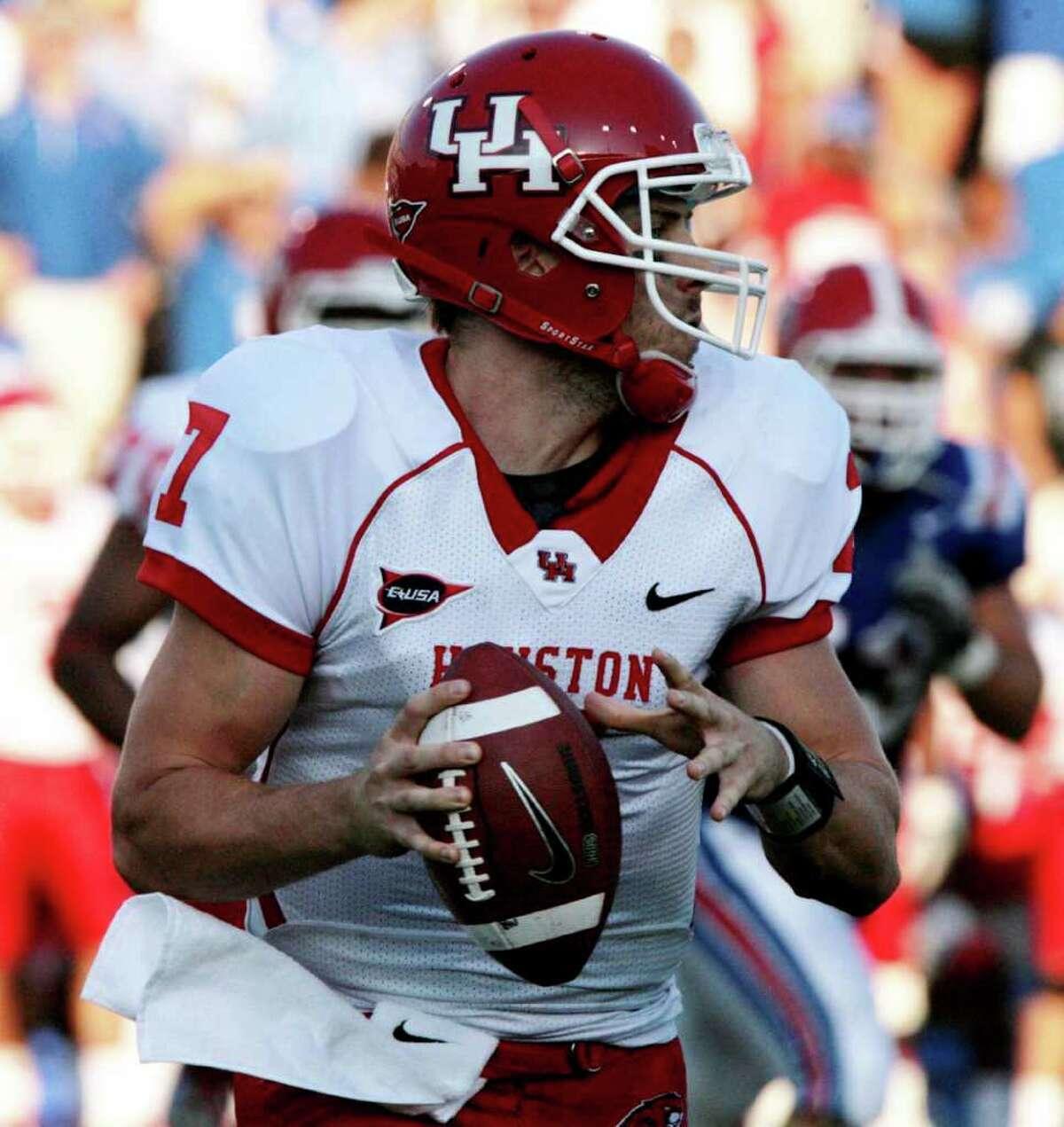 Houston quarterback Case Keenum (7) looks to throw a pass against Louisiana Tech during their NCAA college football game, Saturday, Sept. 17, 2011, in Ruston, La. (AP Photo/The News-Star, Ben Corda)