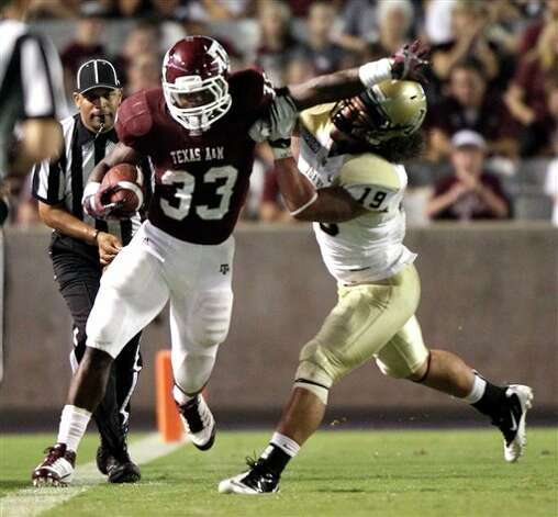 Texas A&M running back Christine Michael (33) is forced out-of-bounds by Idaho linebacker Homer Mauga (19) during the third quarter of an NCAA college football game Saturday, Sept. 17, 2011, in College Station, Texas. (AP Photo/David J. Phillip) Photo: Associated Press
