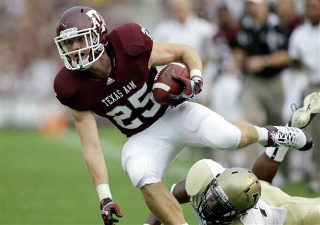 Texas A&M wide receiver Ryan Swope (25) catches a pass as Idaho safety Quin Ashley (12) defends during the first quarter of an NCAA college football game, Saturday, Sept. 17, 2011, in College Station, Texas. (AP Photo/David J. Phillip) Photo: Associated Press