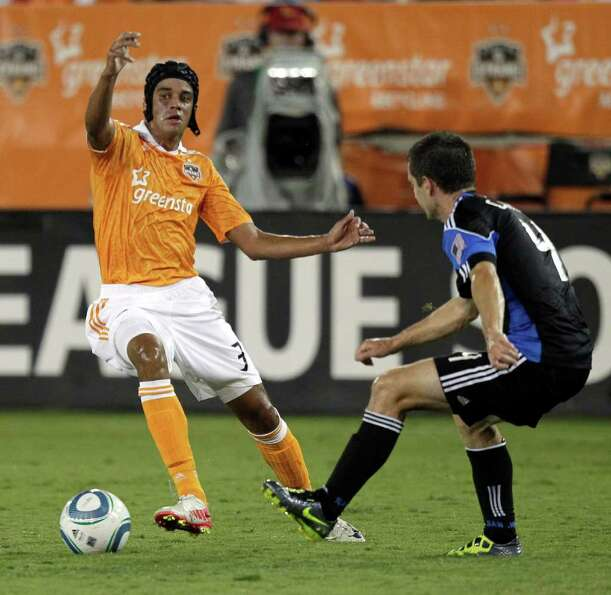 Calen Carr #3 of the Houston Dynamo makes a move on Sam Cronin #4 of the San Jose Earthquakes in the