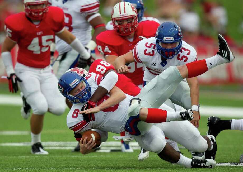 West Brook quarterback Joshua Stump (8) is slammed to the turf for a loss by Katy defensive lineman Cory Lyons (98) during the first half in a high school football game at  Rhodes Stadium, Saturday, Sept. 17, 2011, in Houston. ( Smiley N. Pool / Houston Chronicle ) Photo: Smiley N. Pool, Staff / © 2011  Houston Chronicle
