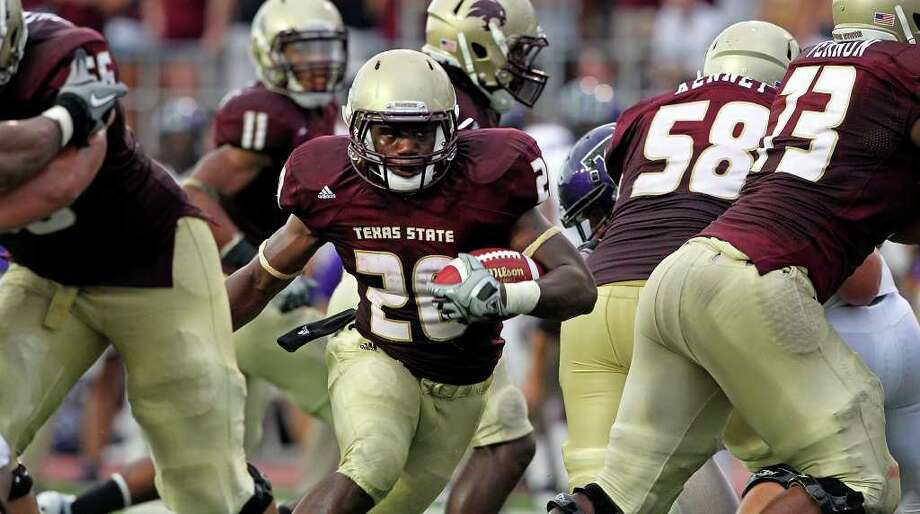 SPORTS    Bobcat running back Terrence Franks gets running room behind a wall of blockers as Texas State takes on the Tarleton Texans at Bobcat Stadium on September 17, 2011.  Tom Reel/Staff Photo: TOM REEL, Express-News / © 2011 San Antonio Express-News
