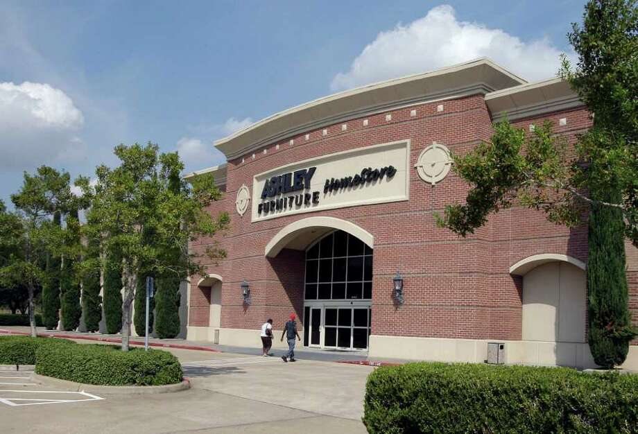 James Nielsen : Chronicle THINKING ABOUT IT: Hill Country Holdings, which owns nine Ashley Furniture HomeStores in the Houston area, including this one on U.S. 59 South, is considering subleasing space inside its locations to other retailers. Photo: James Nielsen / © 2011 Houston Chronicle