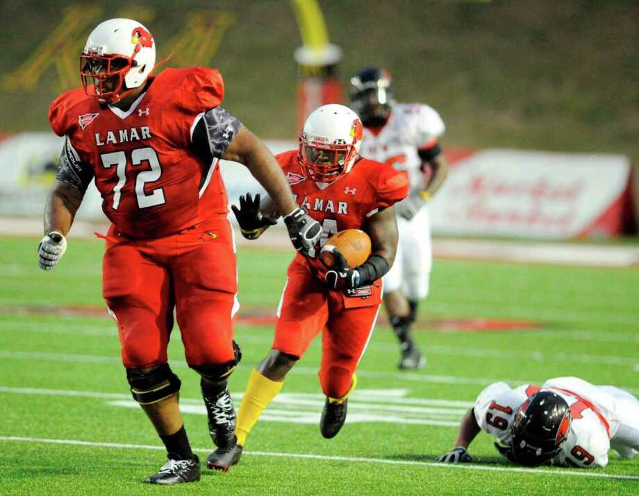 Cardinals running back DePauldrick Garrett (14) rushes behind the wall of Lamar left tackle Daniel Campbell (72) in the first half against  Incarnate Word at Provost Umphrey Stadium Saturday, September 17, 2011. Valentino Mauricio/The Enterprise Photo: Valentino Mauricio